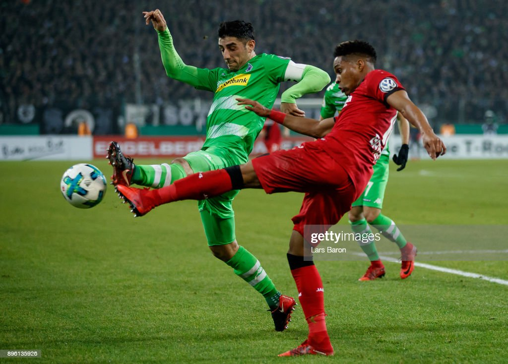 Lars Stindl of Moenchengladbach challenges Wendell of Bayer Leverkusen during the DFB Cup match between Borussia Moenchengladbach and Bayer Leverkusen at Borussia-Park on December 20, 2017 in Moenchengladbach, Germany.