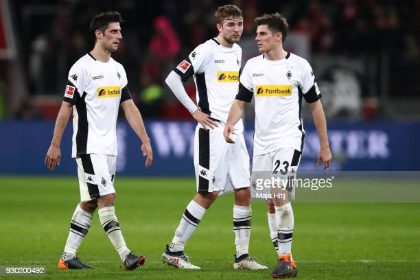 Lars Stindl of Moenchengladbach Christoph Kramer and Jonas Hofmann react after the Bundesliga match between Bayer 04 Leverkusen and Borussia...