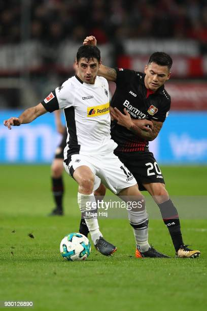 Lars Stindl of Moenchengladbach fights for the ball with Aranguiz of Bayer Leverkusen during the Bundesliga match between Bayer 04 Leverkusen and...