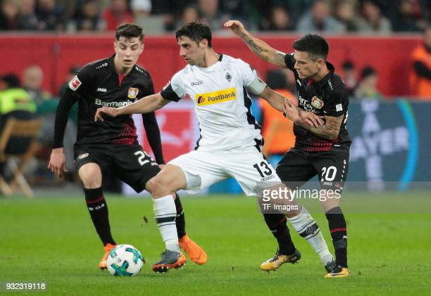 Lars Stindl of Moenchengladbach fights for the ball with Charles Aranguiz and Kai Havertz of Leverkusen during the Bundesliga match between Bayer 04...