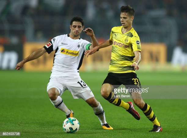 Lars Stindl of Moenchengladbach fights for the ball with Julian Weigl of Dortmund during the Bundesliga match between Borussia Dortmund and Borussia...