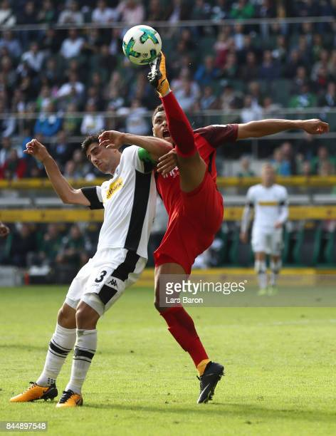 Lars Stindl of Moenchengladbach fights for the ball with Simon Falette of Frankfurt during the Bundesliga match between Borussia Moenchengladbach and...