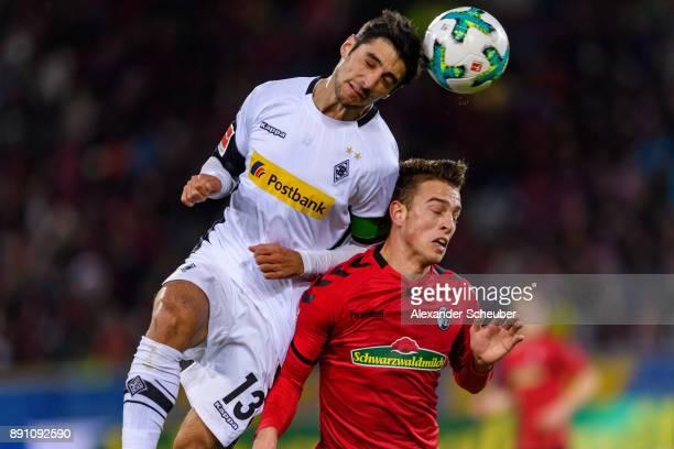 Lars Stindl of Moenchengladbach in action against Janik Haberer of Freiburg during the Bundesliga match between SportClub Freiburg and Borussia...