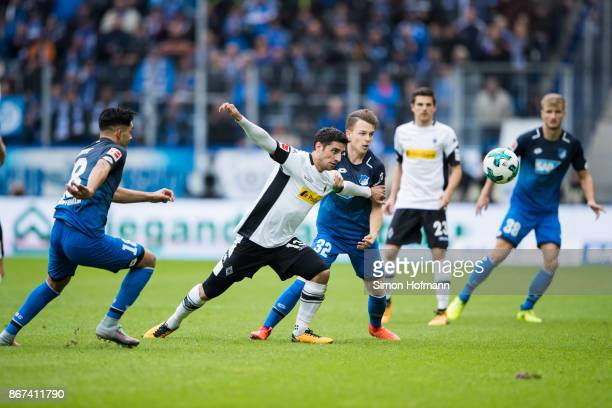 Lars Stindl of Moenchengladbach is challenged by Dennis Geiger of Hoffenheim during the Bundesliga match between TSG 1899 Hoffenheim and Borussia...
