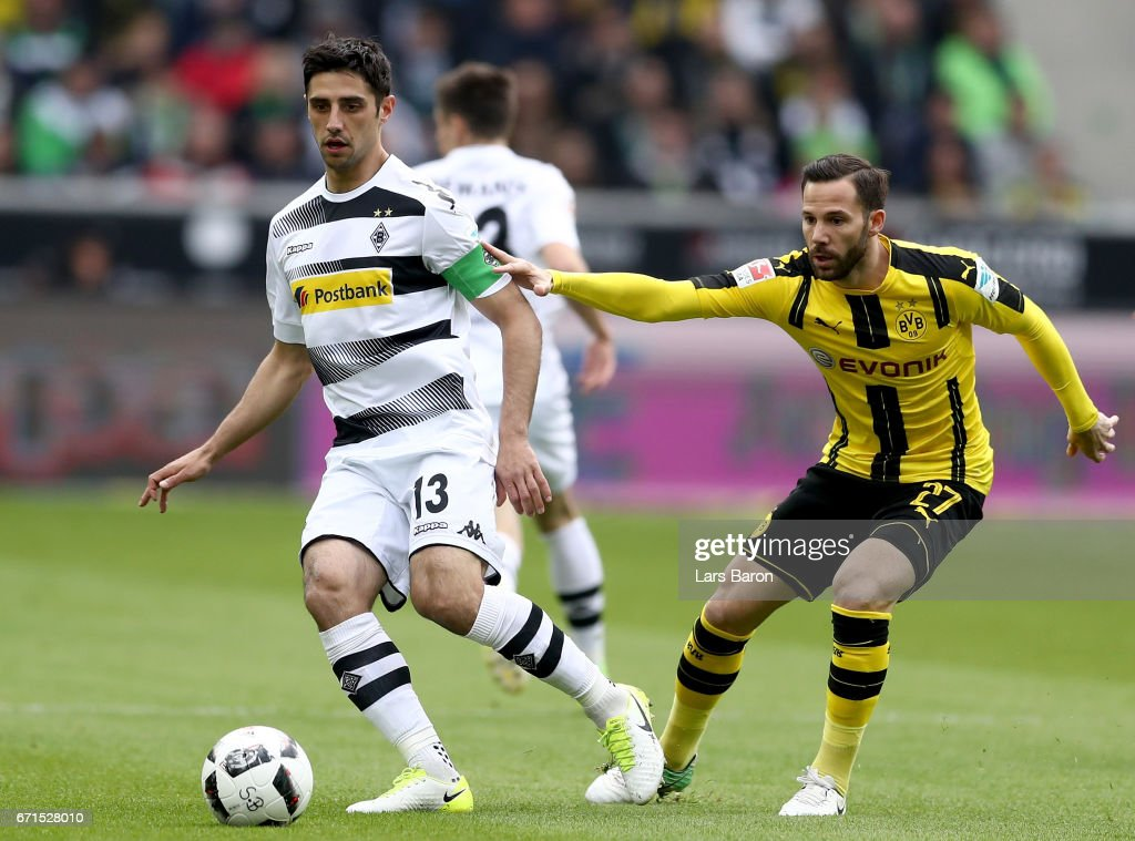 Lars Stindl of Moenchengladbach is challenged by Gonzalo Castro of Dortmund during the Bundesliga match between Borussia Moenchengladbach and Borussia Dortmund at Borussia-Park on April 22, 2017 in Moenchengladbach, Germany.