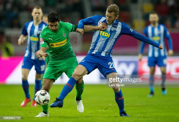 Lars Stindl of Moenchengladbach is challneged by Fabian Lustenberger of Berlin during the Telekom Cup Semifinal match between Borussia...