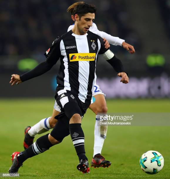Lars Stindl of Moenchengladbach is chased by Amine Harit of Schalke during the Bundesliga match between Borussia Moenchengladbach and FC Schalke 04...