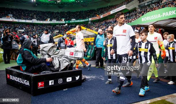 Lars Stindl of Moenchengladbach is seen with mascot kids prior to the Bundesliga match between Borussia Moenchengladbach and TSG 1899 Hoffenheim at...