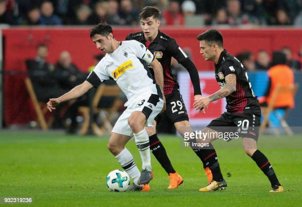 Lars Stindl of Moenchengladbach Kai Havertz and Charles Aranguiz of Leverkusen battle for the ball during the Bundesliga match between Bayer 04...