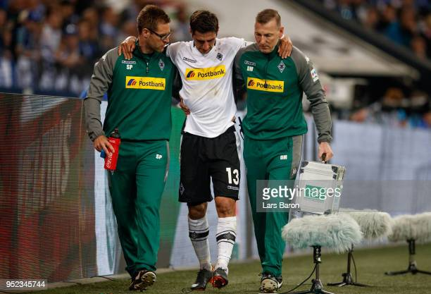 Lars Stindl of Moenchengladbach leaves injured the pitch during the Bundesliga match between FC Schalke 04 and Borussia Moenchengladbach at...