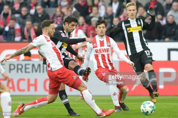 Lars Stindl of Moenchengladbach Marco Hoeger of Koeln and Jorge Mere of Koeln battle for the ball during the Bundesliga match between 1 FC Koeln and...