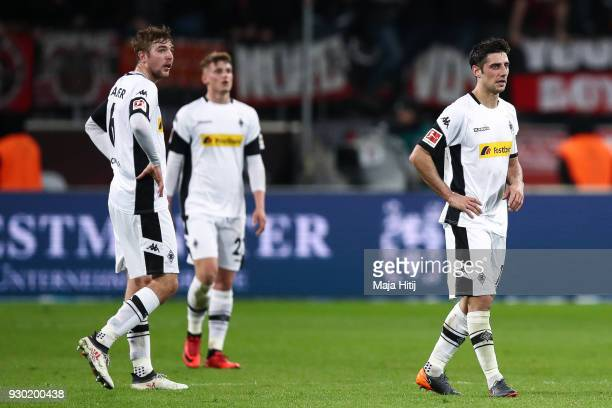 Lars Stindl of Moenchengladbach Michael Cuisance and Christoph Kramer react after the Bundesliga match between Bayer 04 Leverkusen and Borussia...