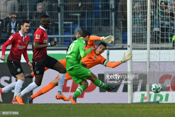 Lars Stindl of Moenchengladbach misses to score against goalkeeper Philipp Tschauner of Hannover during the Bundesliga match between Hannover 96 and...