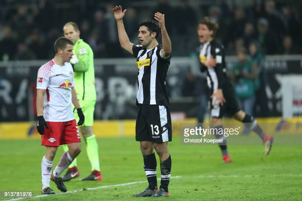 Lars Stindl of Moenchengladbach raises his arms questioning a handball during the Bundesliga match between Borussia Moenchengladbach and RB Leipzig...