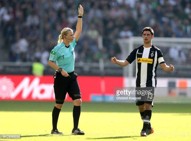 Lars Stindl of Moenchengladbach reacts after referee Bibiana Steinhaus rejects the goal of Patrick Herrmann during the Bundesliga match between...