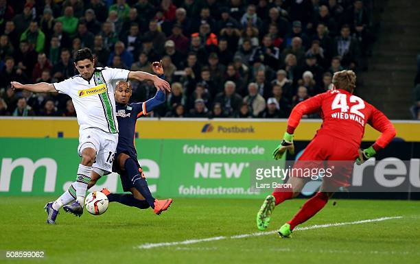Lars Stindl of Moenchengladbach scores his teams first goal during the Bundesliga match between Borussia Moenchengladbach and Werder Bremen at...