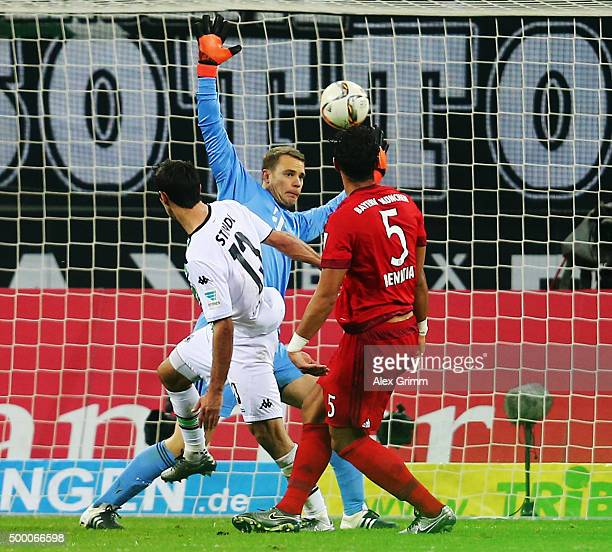 Lars Stindl of Moenchengladbach scores his team's second goal against Mehdi Benatia and goalkeeper Manuel Neuer of Muenchen during the Bundesliga...
