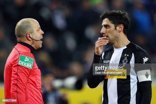 Lars Stindl of Moenchengladbach speaks with linesman Mike Pickel after his goal was disallowed due to an offside decision during the Bundesliga match...