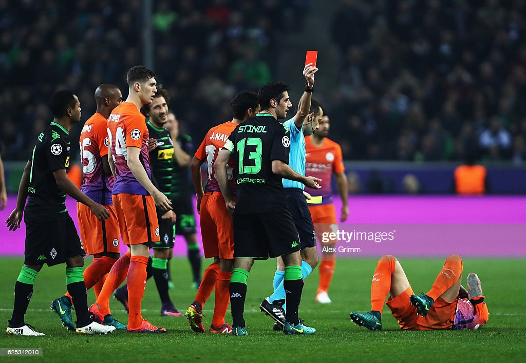 Lars Stindl of VfL Borussia Moenchengladbach is shown a red card by referee Cueneyt Cakir during the UEFA Champions League match between VfL Borussia Moenchengladbach and Manchester City FC at Borussia-Park on November 23, 2016 in Moenchengladbach, North Rhine-Westphalia.