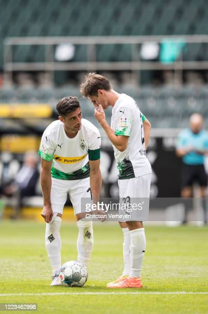 Lars Stindl talks to Jonas Hofmann of Borussia Moenchengladbach during the Bundesliga match between Borussia Moenchengladbach and Hertha BSC at...