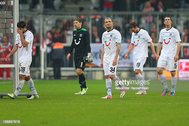 Lars Stindls of Hannover looks dejected with his team mates Robert Ziegler Konstantin Rausch Christian Schulz and Mario Eggimann after the Bundesliga...