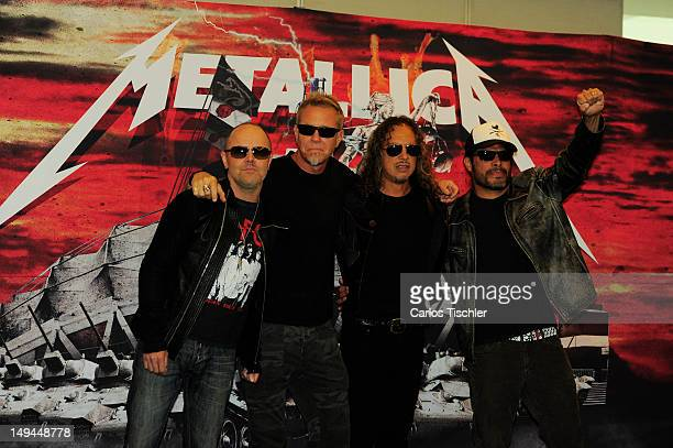 Lars Ulrich James Hetfield Kirk Hammett and Robert Trujillo of Metallica pose for the photo in the press conference Metallica the full arsenal during...