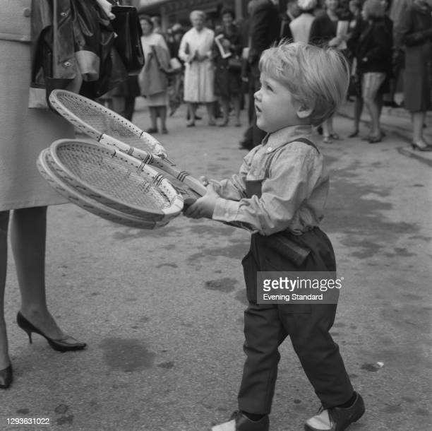 Lars Ulrich, the son of Danish tennis player Torben Ulrich, accompanies his father to Wimbledon, London, UK, June 1966. Lars later became the drummer...