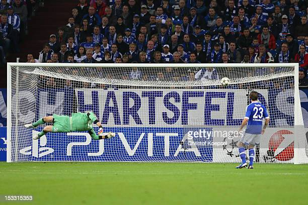 Lars Unnerstaallnd Christian Fuchs of Schalke get the first goal during the UEFA Champions League group B match between FC Schalke 04 and Montpellier...