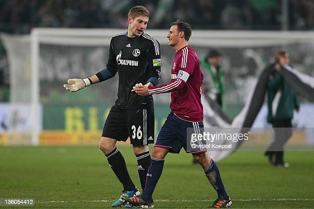 Lars Unnerstall and Benedikt Hoewedes of Schalke look dejected during the DFB Cup round of sixteen match between Borussia Moenchengladbach and FC...