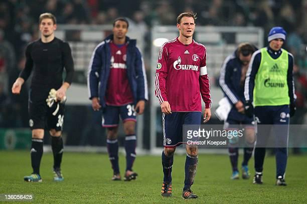 Lars Unnerstall, Joel Matip, Benedikt Hoewedes and Christoph Moritz of Schalke look dejected after the DFB Cup round of sixteen match between...
