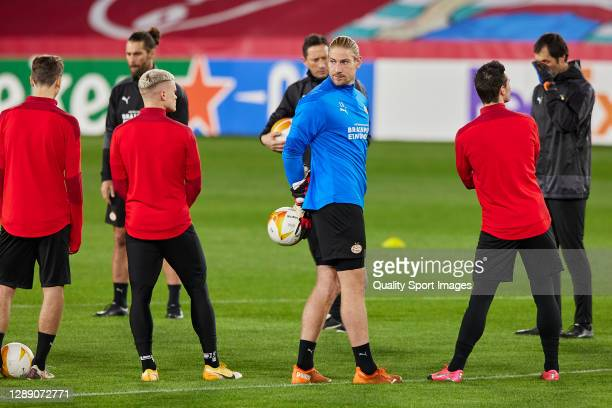 Lars Unnerstall of PSV Eindhoven turns around during training session ahead of the UEFA Europa League Group E stage match between PSV Eindhoven and...