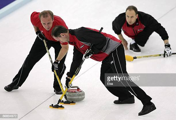 Lars Vaagberg watches his teammates Bent Aanund Ramsfjell and Flemming Davanger of Norway sweep during the preliminary round of the men's curling...