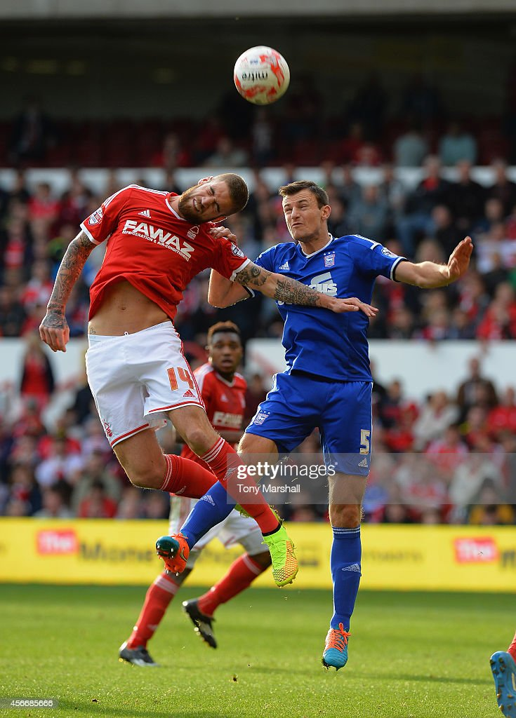 Lars Veldwijk of Nottingham Forest challenges Tommy Smith of Ipswich Town during the Sky Bet Championship match between Nottingham Forest and Ipswich Town at City Ground on October 5, 2014 in Nottingham, England.