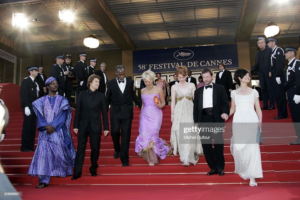 Lars Von Trier poses with his actors on the red steps at the preview of 'Manderlay',Lars Von Trier's movie, at the Grand Theatre Lumiere on May 16, 2005 in Cannes, France.