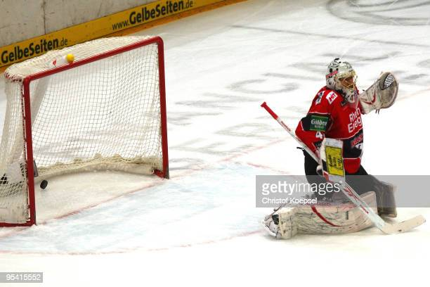Lars Weibel of Koelner Haie gets the first goal during the DEL match between Koelner Haie and Frankfurt Lions at the Lanxess Arena on December 27...