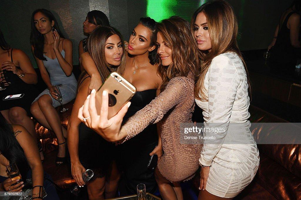 Larsa Pippen, Kim Kardashian West, Maria Menounos and Carla DiBello pose for a selfie as they attend Hakkasan Las Vegas Nightclub inside MGM Grand on July 22, 2016 in Las Vegas, Nevada.