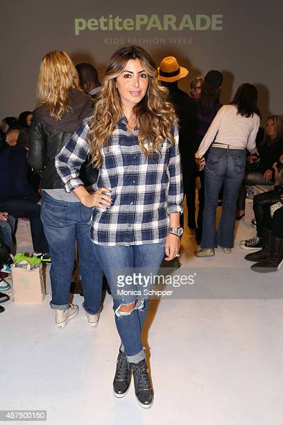 Larsa Pippen poses before the Ruum preview at petitePARADE / Kids Fashion Week at Bathhouse Studios on October 19 2014 in New York City
