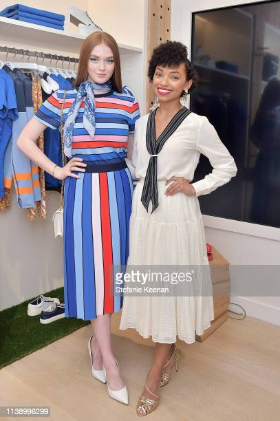 Larsen Thompson and Logan Browning attend Tory Burch & The Daily Celebrate Spring with Tory Burch Eau de Parfum at Tory Burch on April 23, 2019 in...
