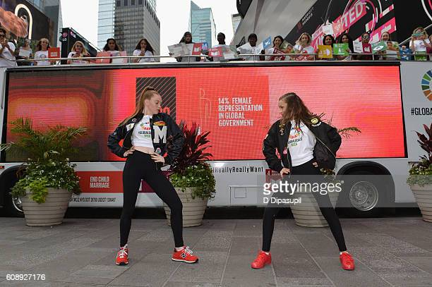Larsen Thompson and Taylor Hatala dance in front of the 2016 Global Goals Girls Bus in Times Square on September 20 2016 in New York City
