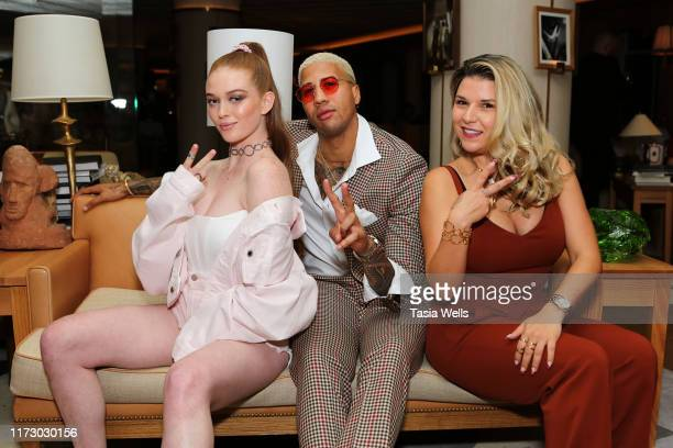Larsen Thompson, Miles Watson and Alicia Sereno pose for a photo during the Lilou NYFW dinner at L'Avenue on September 07, 2019 in New York City.