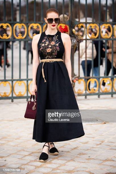 Larsen Thompson wearing a black decorated dress Dior belt and burgundy Dior bag is seen outside Dior during Paris Fashion Week Womenswear Fall/Winter...