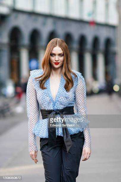 Larsen Thompson wears a blue low-neck mesh ruffled top, a belt, black pants, outside Philosophy, during Milan Fashion Week Fall/Winter 2020-2021 on...