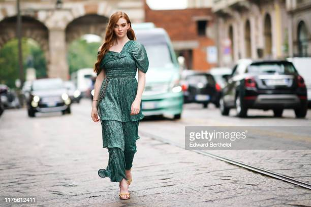 Larsen Thompson wears a green shiny ruffled dress outside the Peter Pilotto show during Milan Fashion Week Spring/Summer 2020 on September 18 2019 in...