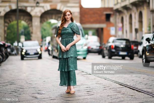 Larsen Thompson wears a green shiny ruffled dress, outside the Peter Pilotto show during Milan Fashion Week Spring/Summer 2020 on September 18, 2019...