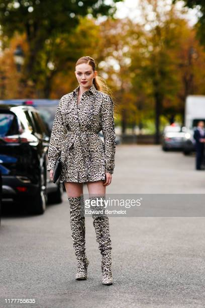 Larsen Thompson wears a jaguar animal print dress, thigh high boots, a black clutch, outside Elie Saab, during Paris Fashion Week - Womenswear Spring...