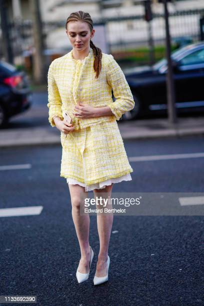 Larsen Thompson wears a yellow checked tweed jacket outside Shiatzy Chen during Paris Fashion Week Womenswear Fall/Winter 2019/2020 on March 04 2019...