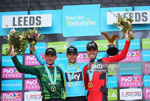 Lars-Petter Nordhaug of Norway and Team Sky celebrates on the podium after his overall victory with second place Samuel Sanchez of Spain and BMC...