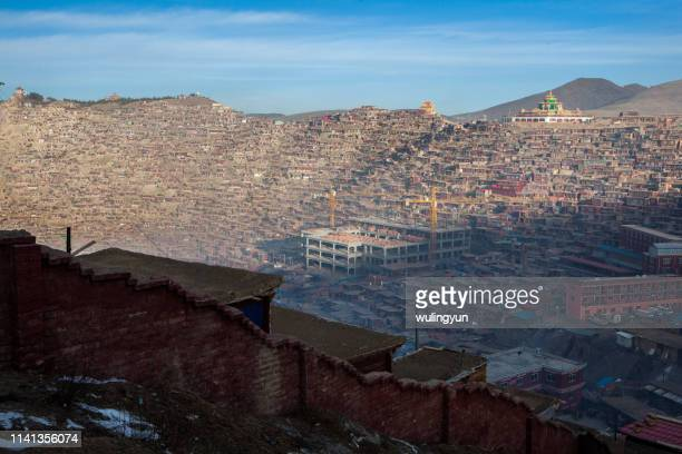 larung gar buddhist academy after snow - after stock photos and pictures