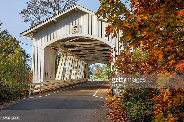 larwood covered bridge, with autumn foliage - covered bridge stock pictures, royalty-free photos & images