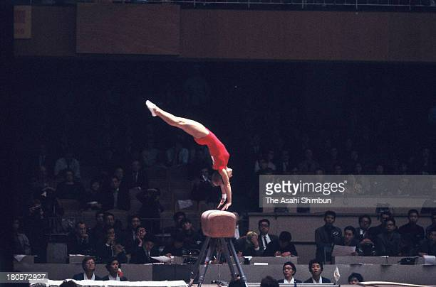 Larysa Latynina of Soviet Union competes in the Horse Vault of the Women's Artistic Gymnastics Individual AllAround during the Tokyo Olympics at...